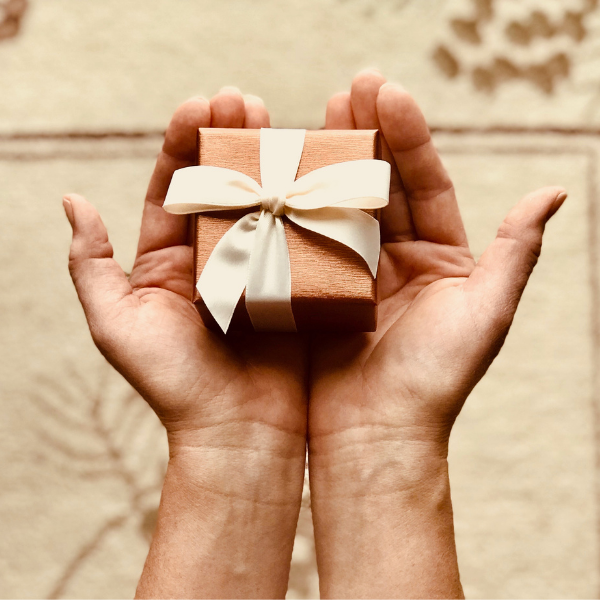 hands holding small gift box